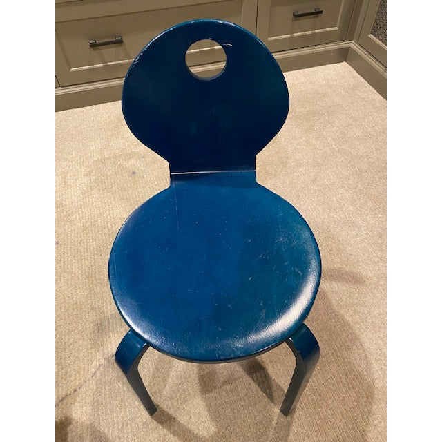 Cute children's cosmic cobalt blue bent wood seat chair. Molded plywood construction. All edges are shaped to a soft...