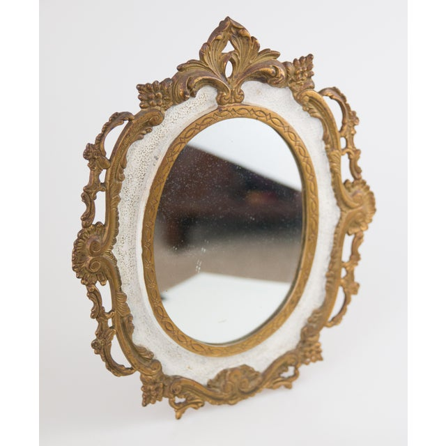 A gorgeous antique French bronze table dressing mirror with gilt floral border, circa 1900. This lovely mirror is heavy...