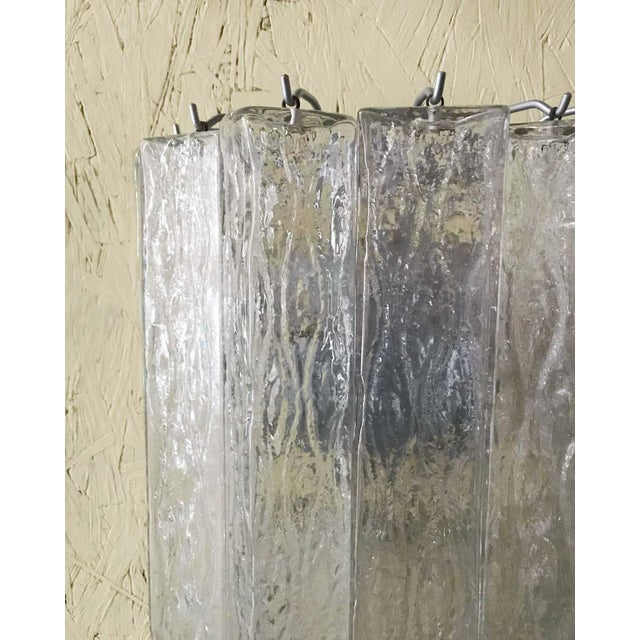 Original vintage pair of Italian wall lights with clear rectangular Murano glass tubes mounted on painted metal frames,...