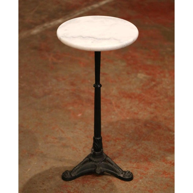 This elegant, antique round pedestal table was crafted in Southern France, circa 1920. With the original patinated black...