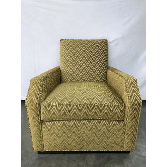 The Castiel Chair is a first quality market sample that features a gold patterned fabric.
