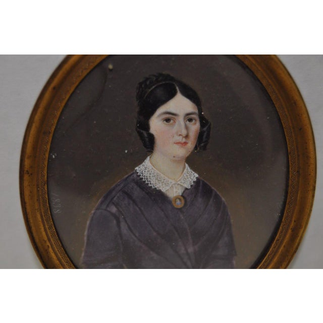 Mid 19th Century Miniature Portrait of a Young Woman c.1838 The sitter is wearing her favorite purple dress and wears her...