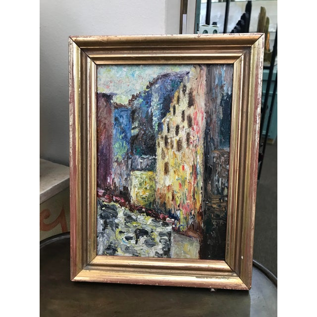 An early 20th century European impressionist style street scene in an antique gilt frame. No signature.