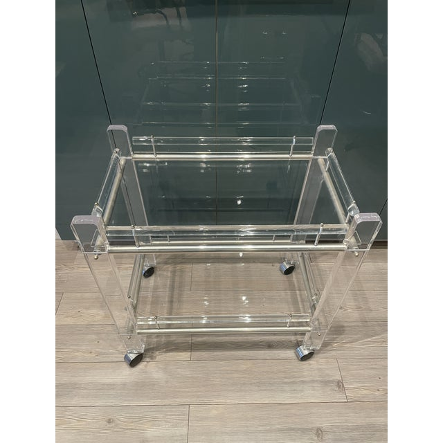 Estate sale find! Vintage Charles Hollis Jones lucite bar cart with two tiers. Perfect for glassware on top and liquor...