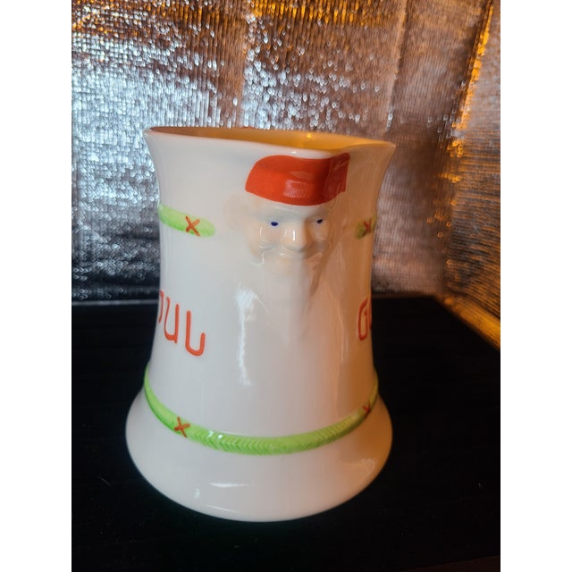 Festive Swedish Porcelain Pitcher adorned with Jultomten ( Christmas Gnome) on spout and handle. This discontinued pattern...