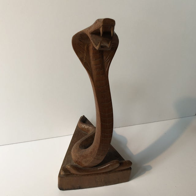 Cobra sculpture craved from one piece of wood. Very detailed with sharp fangs.