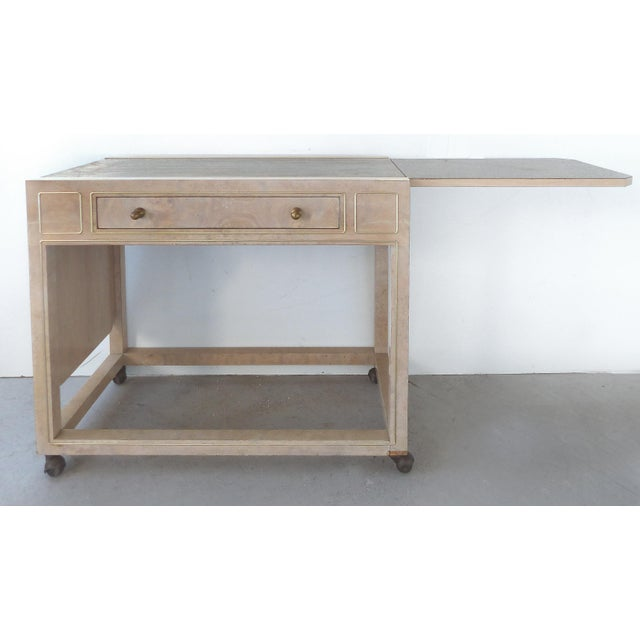 Offered for sale is a Mastercraft rolling server in a washed elm with an acid etched serving surface by Bernhard Rohne....