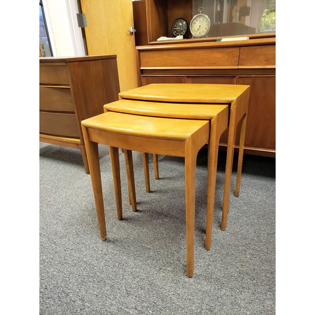 Beautiful 3 piece space-saving nesting table set (wood is probably birch or maple). The edges have a nice decorative...