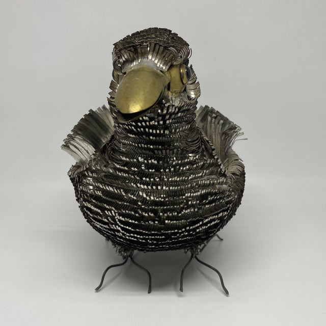 Vintage Sergio Bustamante metal tin bird sculpture. Whimsical and has great juxtaposition with the metal feathers.