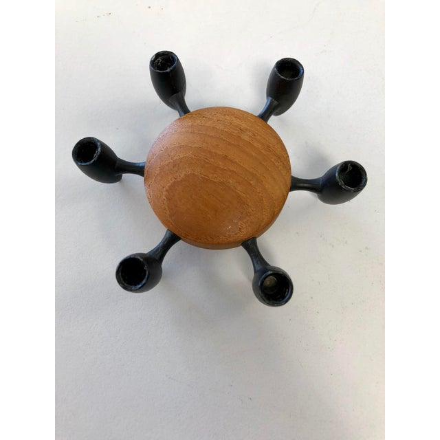 Holds 6 candles. Denmark made from teak and black metal. Perfect for your next dinner party!