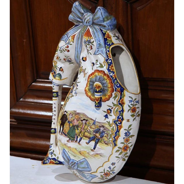 This interesting antique wall decoration was sculpted in central France, circa 1890. The ceramic, hand-painted bagpipe...