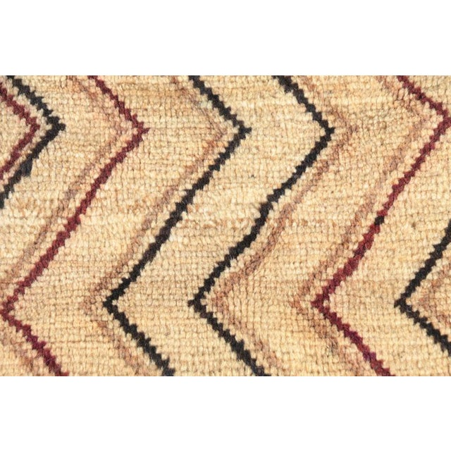 A hand-knotted Persian Gabbeh accent rug. This wool pile rug has a foundation woven from the softer undercoats of goats...