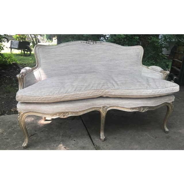 beautiful, one of a kind silver leaf settee, older frame which has been painted, with brand new upholstery. This silver...