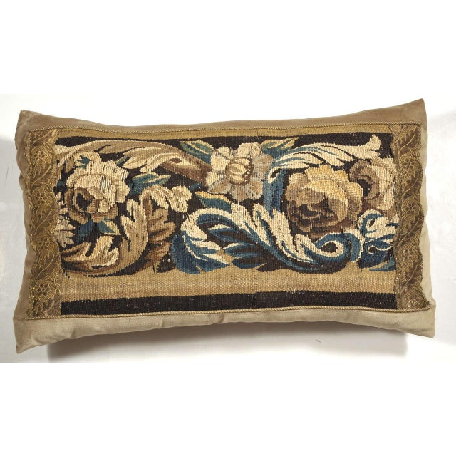 Beautiful florals and leafs are depicted in golds, browns and blues in this pillow. It is made from a 19th century French...