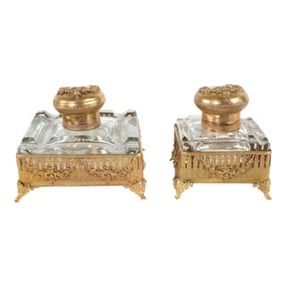 Ornately Gilt Brass Framed Footed Glass Inkwells - A Pair For Sale