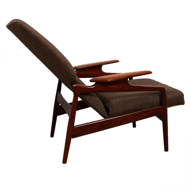 This oversized lounge chair attributed to Finn Juhl, offers the added luxury of reclining. In fact the chair seat moves...
