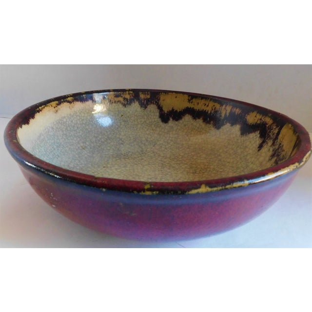 I love the color combination of this glazed pottery bowl. The taupe crackled inside and deep outside claret duo will work...