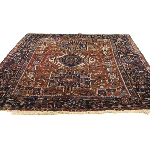 77066 Antique Persian Heriz rug with medallion and cruciform motif. This opulent antique Persian Heriz rug features a...