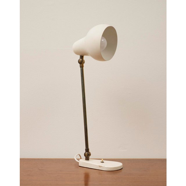 Vilhelm Lauritzen table lamp in brass, designed for the Radiohuset building in Copenhagen in 1942. With white painted...