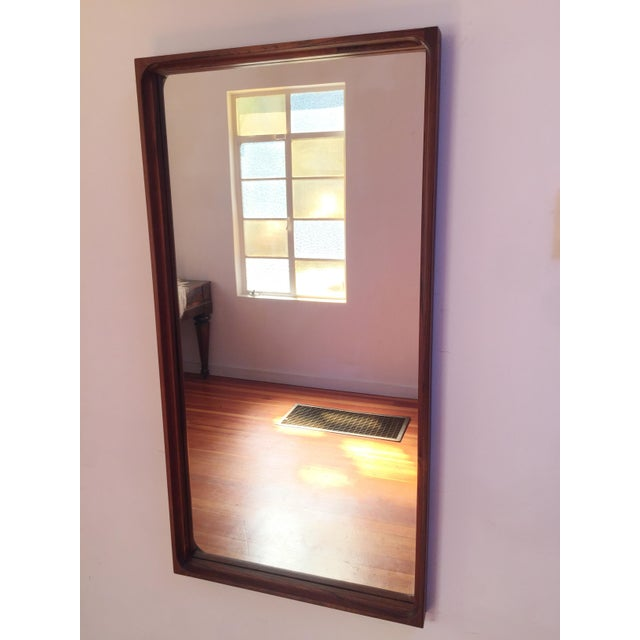 You're looking at a beautiful Swedish mid-century modern mirror made by Glãs Master. The model number is 176. This is a...