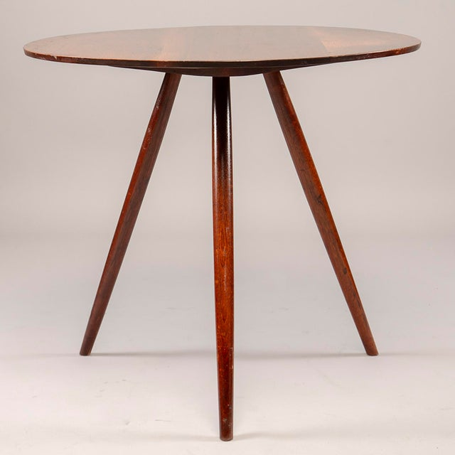 Circa early 1950s round, splayed leg, hand-honed side table by George Nakashima. Original owner purchased this table...