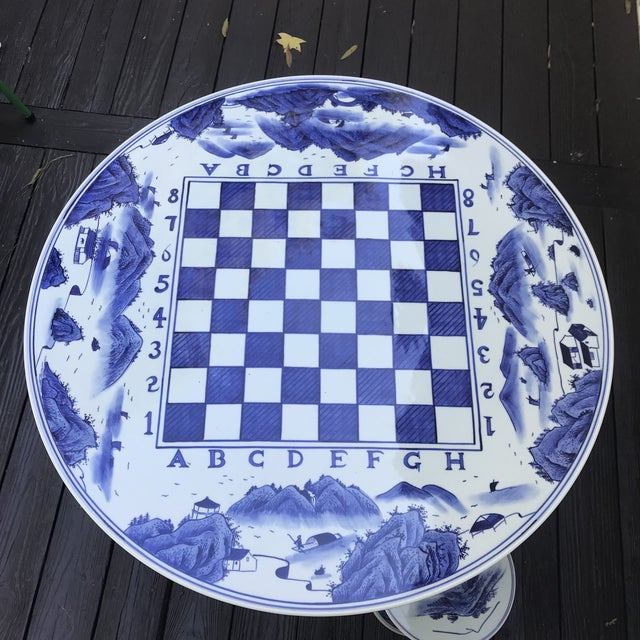 """Rare chinoiserie blue and white ceramic game table with 4 matching stools. Table measures 35.5"""" wide by 27.5"""" high Stools..."""