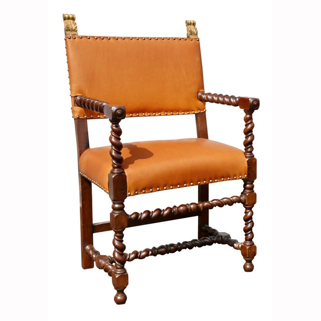 With acanthus form giltwood finials over new leather back with brass tacks, same seat, barley twist arms and legs,...