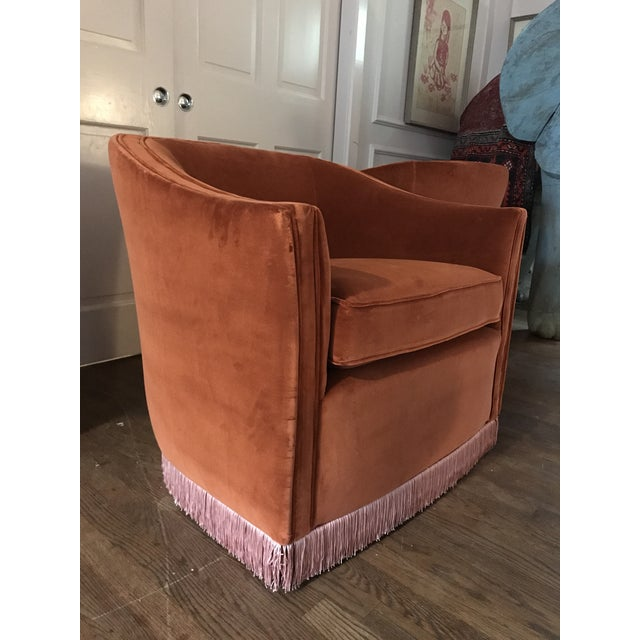 Vintage, high-quality chairs on a solid wooden swivel. Reupholstered in a rust velvet with contrasting salmon fringe....