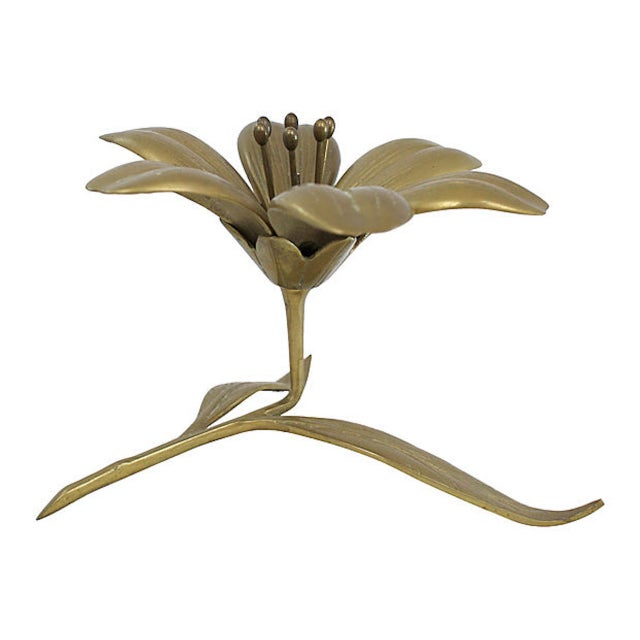 Midcentury solid brass sculptural flower ashtray with six removable petal ashtrays. No maker's mark. Minimal age wear.