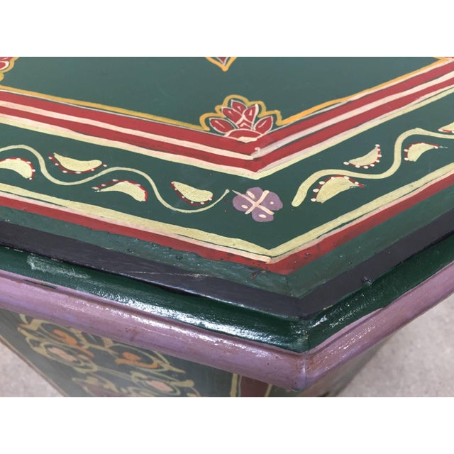 Moroccan colorful hand painted dark green side table with Moorish designs cut out work on sides. Dark green background...