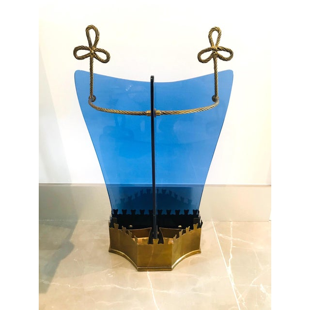 Rare Mid-Century Modern umbrella stand with unique design. Gilt wrought iron frame fitted with tapered glass in beautiful...