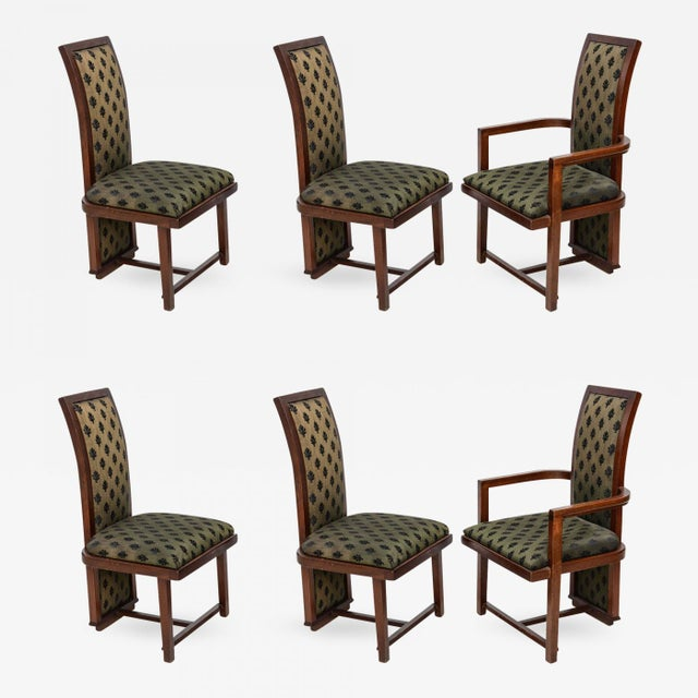 Set of 12 dining chairs comprising two arms and four sides.