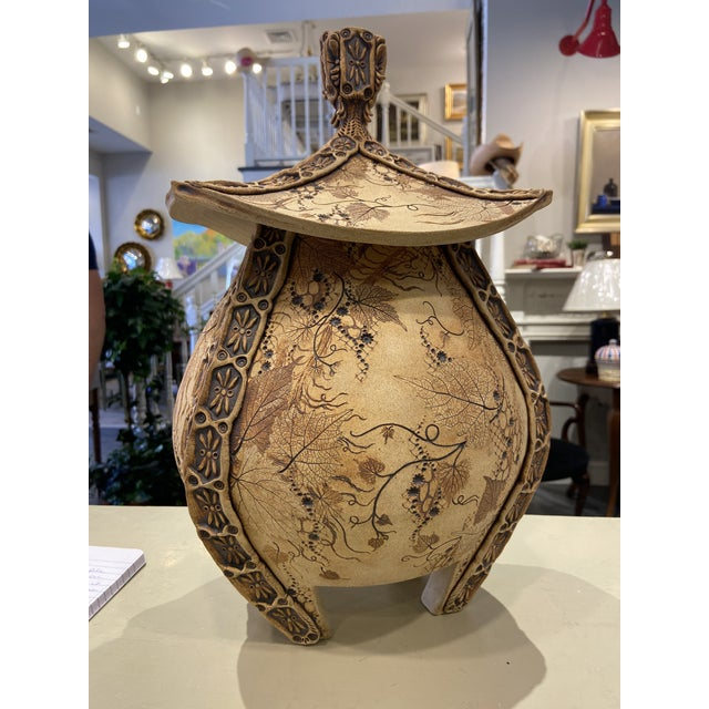 This is a handmade urn with a lid. It is made in 2016 and signed on the bottom by the artist. It has beautiful carved...