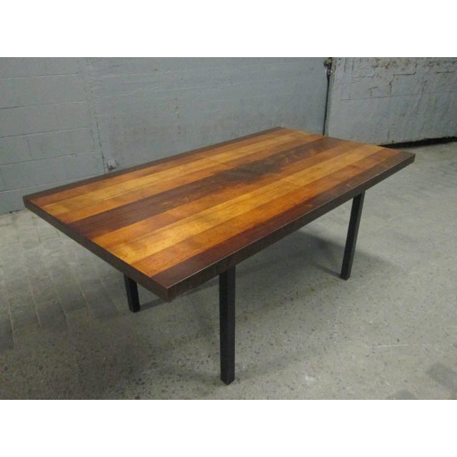 Multi-wood dining table by Milo Baughman for Directional. Table consists of rosewood, mahogany and walnut. Measures (with...