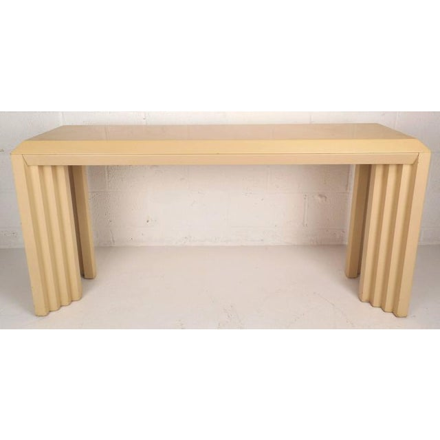 Stunning vintage modern hall table features a lovely cream lacquer finish with unique angled graduated legs. Stylish and...