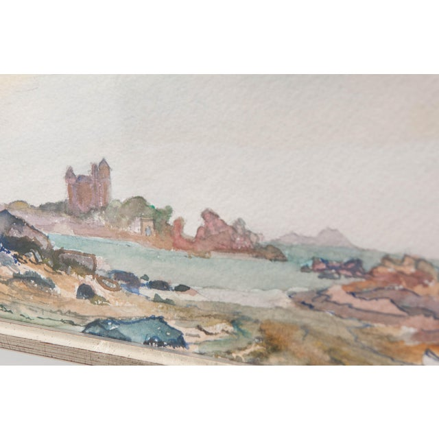 This fine watercolor painting on paper, c. 1890, is from France and depicts a quiet rocky shoreline with a small bateau...