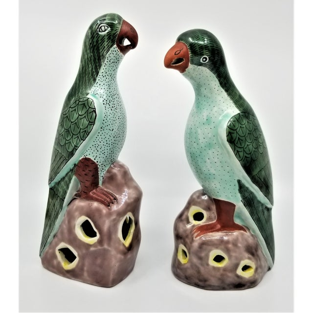 Offering a pair of porcelain ceramic glazed parrot figurines, made in China, circa 1960s. These lovely vintage birds have...