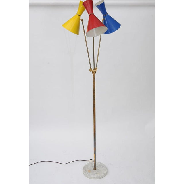 Mid-Century Modern Brass Floor lamp by Stilnovo with three enameled shades on a round marble base. Perfect working...