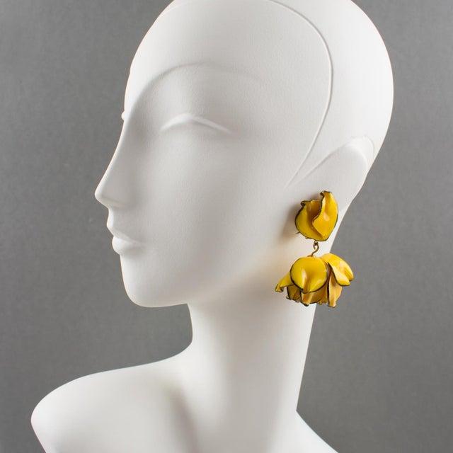 Refreshing dimensional dangling clip-on earrings by Cilea Paris. Floral inspired hand-made artisanal resin or Talosel...