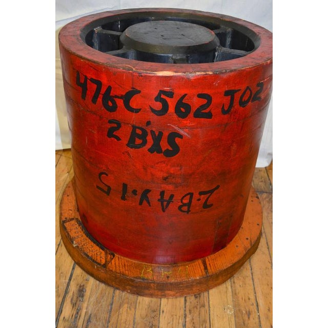 Wooden Industrial pattern as colorful end table complete with factory numbering and lettering. Cleaned and sealed. Heavy,...