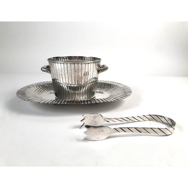 A Mexican sterling silver ice bucket with tongs and tray by Sanborns, all with fluted geometric design and signed. Heavy...