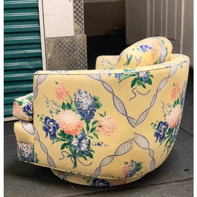 Brunschwig & Fils swivel club chair pastel yellow blue and pink floral hydrangea. A breath of fresh postmodern air for the...
