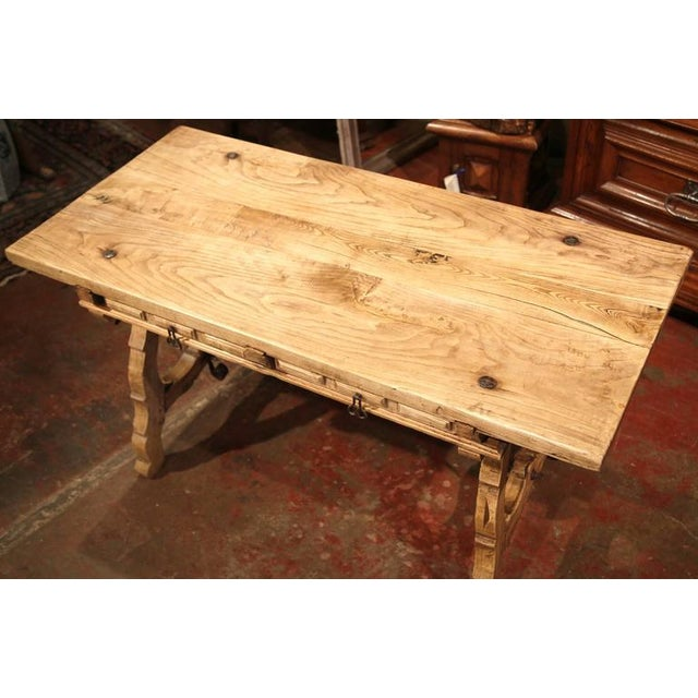 This elegant, antique fruitwood desk was crafted in Spain circa 1870. The rustic writing table has been stripped down from...