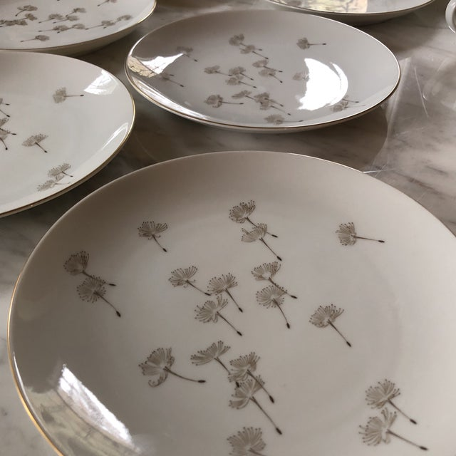 Gorgeous collection of tea cups and plates with a delicately painted dandelion on each piece. 12 plates. 9cups with...