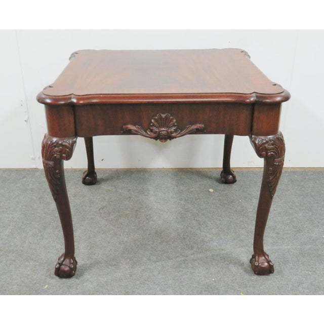 Flamed mahogany banded top, Shell motif decoration. Ancuthus leaves over ball and claw feet.