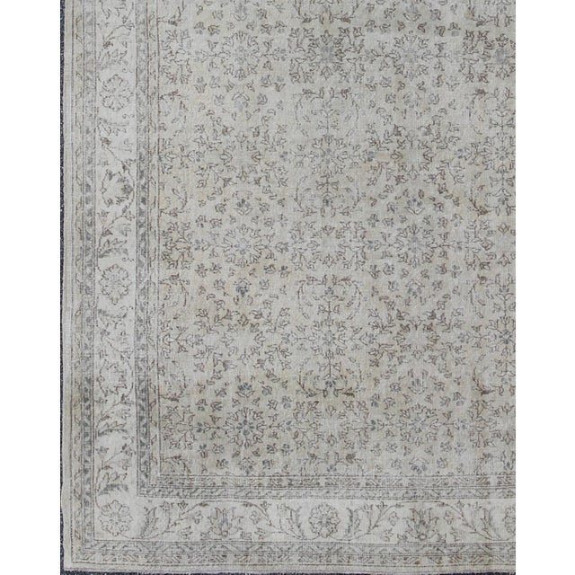 The design of this beautiful vintage Oushak rug from mid-20th century Turkey is enhanced by its lustrous wool and neutral...