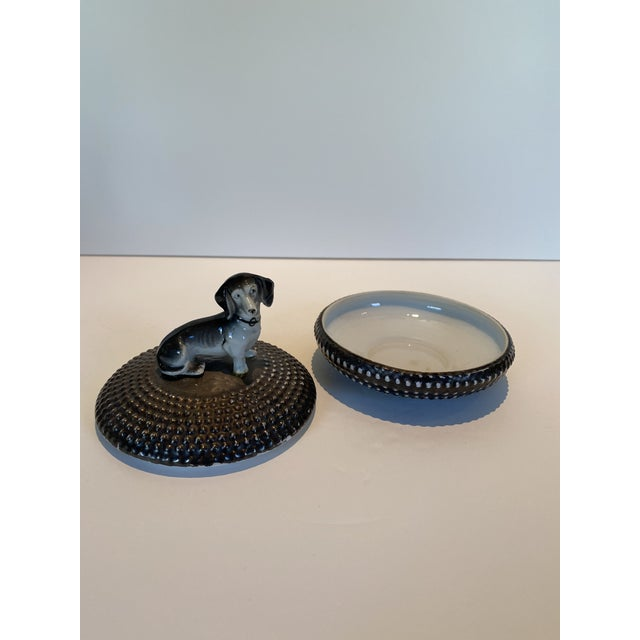 Dorothy Thorpe ceramic circular box with beaded texture and a little ceramic Daushund dog on top