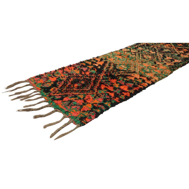 This Vintage Berber Moroccan Runner features a modern tribal design. Cleverly composed with its contemporary abstract...