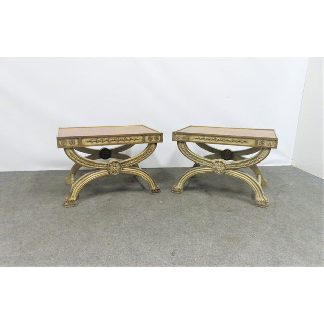 A quality pair of regency style X base side tables or stools, cream painted x bases with carved bellflowers, burlwood tops.