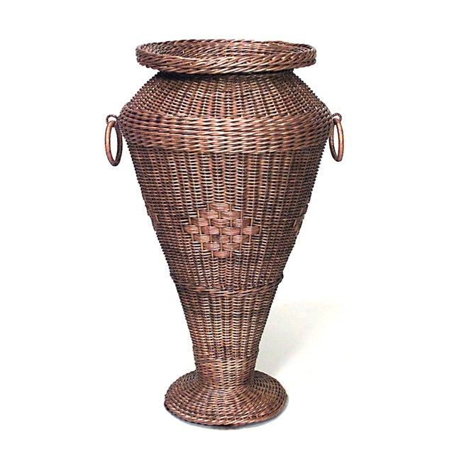 American mission natural wicker umbrella stand with ring handles.
